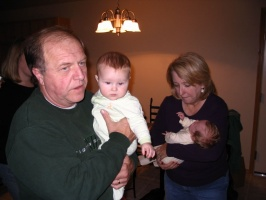 Grandparents holding the babies