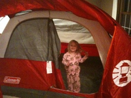 Kaitlyn up late in a tent