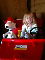 Kaitlyn fighting fires with Snoopy and Woodstock