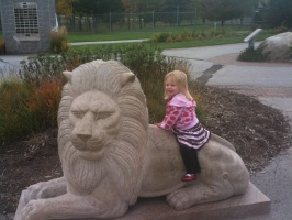 Kaitlyn on a Lion at Green Bay Zoo