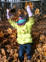 Kaitlyn playing in the leaves