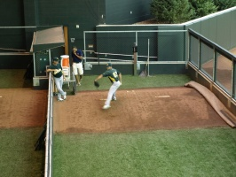 A's Pitcher Warming Up