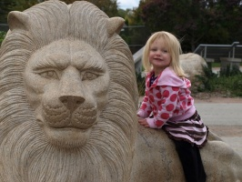 Kaitlyn riding a lion